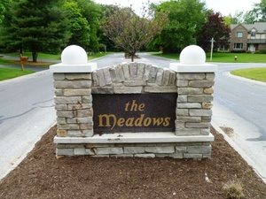 East entrance sign at The Meadows