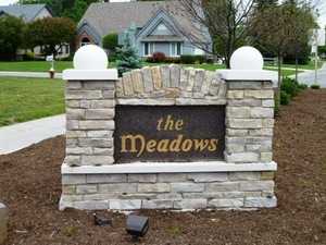 West entrance sign at The Meadows