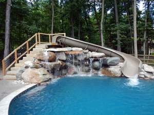 Swimming pool waterfalls and water slide